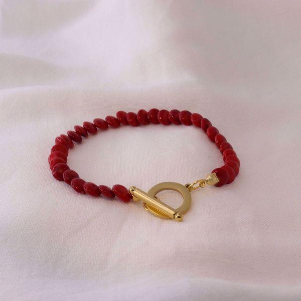 Imagem de Red coral bracelet | golden